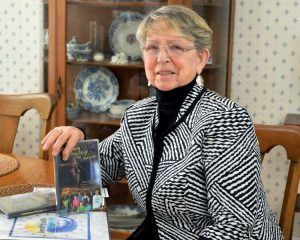 "Educator and storyteller Gert Johnson with DVD's of the upcoming film ""Stepping Toward the Lion"" by John Lyden, an alum of Children at the Well, in her home Wednesday March 19, 2014, in Niskayuna, NY. (John Carl D'Annibale / Times Union) https://s.hdnux.com/photos/27/06/03/6054115/5/750x0.jpg"