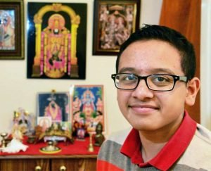 Shaker High School student Varun Mondaiyka, 15, at his home's Hindu shrine Thursday Jan. 18, 2018 in Colonie, NY. (John Carl D'Annibale/Times Union)https://s.hdnux.com/photos/70/71/05/14913902/3/750x0.jpg